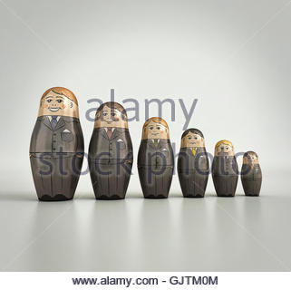 Businessmen nesting dolls in order of size and happiness - Stock Photo