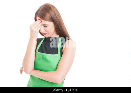 Stressed employee suffering from head ache and looking tired on white background with text area - Stock Photo