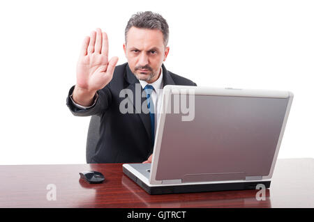 Serious executive manager doing stop sign as rejection gesture concept isolated on white background - Stock Photo