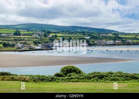 View across golf course and Afon Nyfer river estuary to Newport Sands and village at high tide. Newport Pembrokeshire - Stock Photo