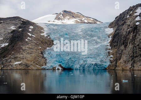 The head of a glacier calving into Prince Christian Sound / Prins Christians Sund in summer. Kujalleq, southern - Stock Photo