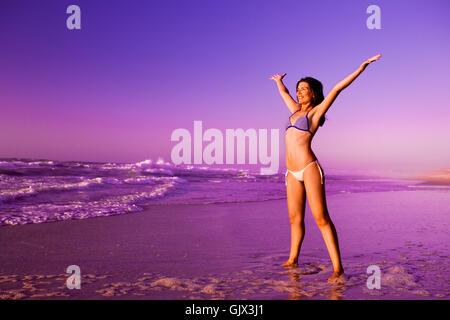 woman sunset beach - Stock Photo