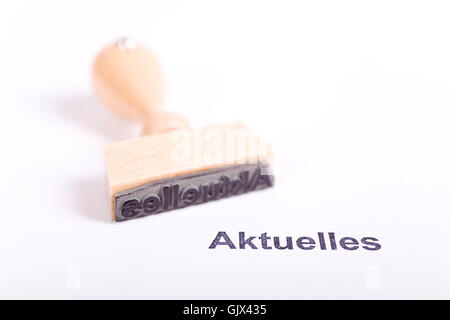 stamp made of wood with the word news - Stock Photo
