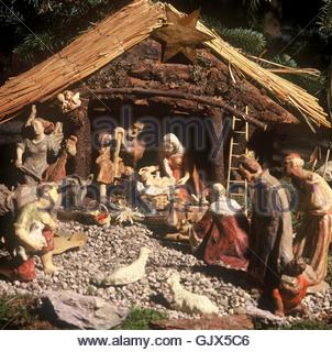 nativity scene with wooden figures - Stock Photo