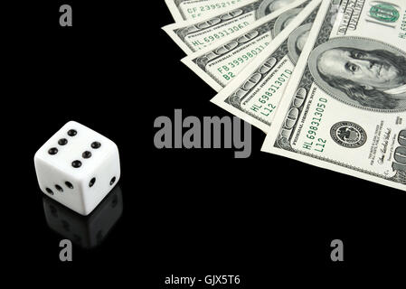 White dice and money on black background - Stock Photo