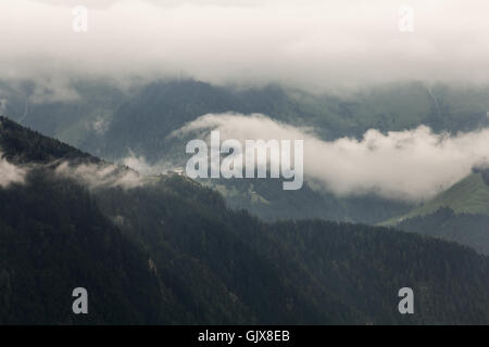 View of a mountain with clouds in a rainy day in Zillertal, Austria - Stock Photo