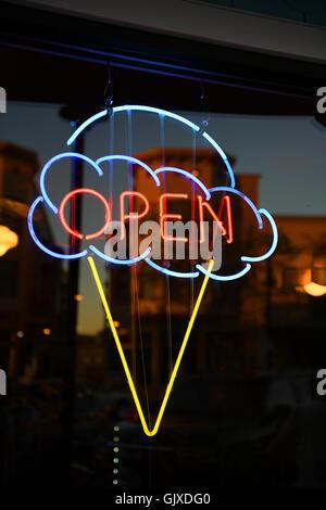 Open ice cream neon sign on window - Stock Photo