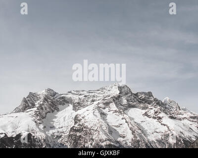 Snow covered mountains in Nepal's Everest Base Camp - Stock Photo
