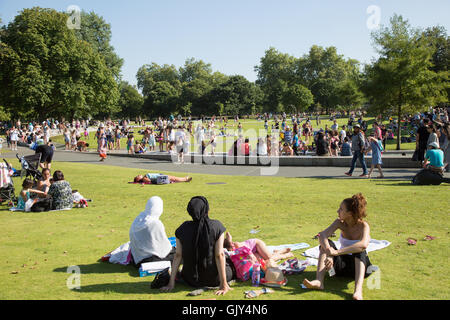 Tourists enjoying the Diana Memorial Fountain Hyde Park London UK - Stock Photo