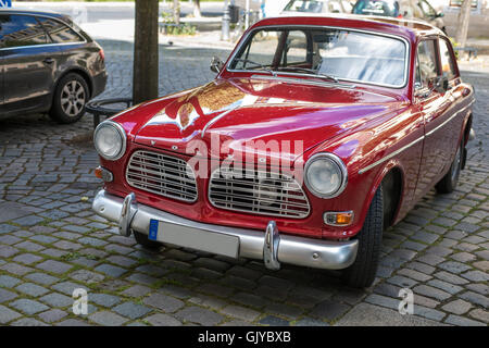 Vintage Volvo 122 S parked on cobblestone - Stock Photo
