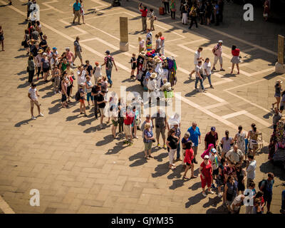 Tourist queuing in line at Piazzetta San Marco, Venice Italy. - Stock Photo