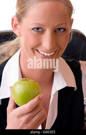 young woman holding apple in her hand - Stock Photo