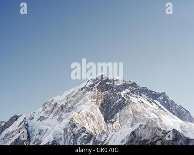 Snow covered Himalayan peak near Lobuche, Nepal on Everest Base Camp - Stock Photo