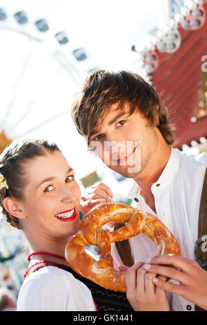 couple in costume at carnival - Stock Photo