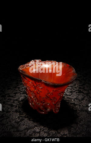 Rhino horn cup carved plum blossom - Stock Photo