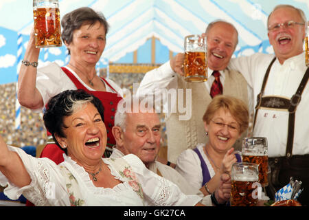 seniors in the beer tent - Stock Photo
