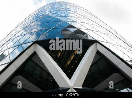 London, England UK. 07 march, 2016. The skyscraper 30 St Mary Axe known as «The Gherkin» seen from street level - Stock Photo