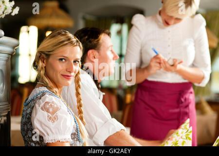 couple ordered in bavarian restaurant - Stock Photo