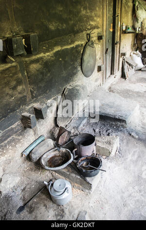 Traditional kitchen in a Kalash house in the Birir valley in northern Pakistan - Stock Photo