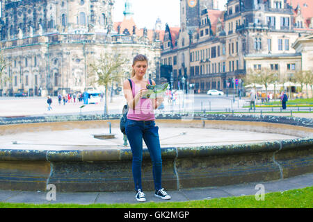 Young woman read travel guid in Dresden. Germany - Stock Photo