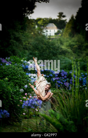 Cscape Dance Company perform their spectacular Neptunalia at Trebah Gardens in Cornwall. - Stock Photo