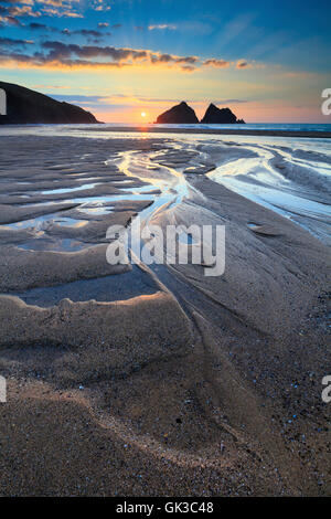 The beach at Holywell Bay on the north coast Cornwall, captured shortly before sunset. - Stock Photo