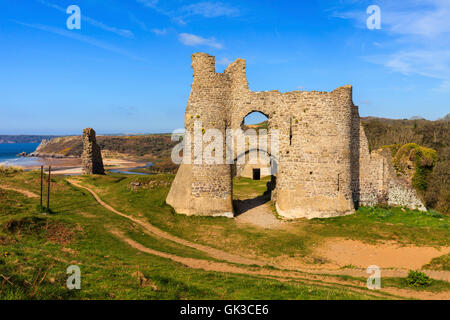Pennard Castle with Three Cliffs Bay in the distance. - Stock Photo
