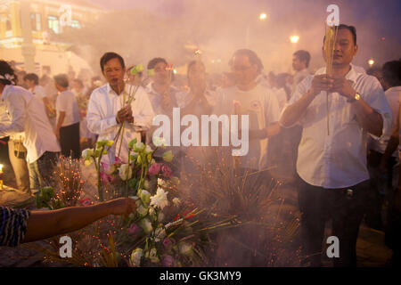 Phnom Penh, Cambodia --- Mourners gather for a week, burning incense and displaying portrait of King Norodom Sihanouk, - Stock Photo