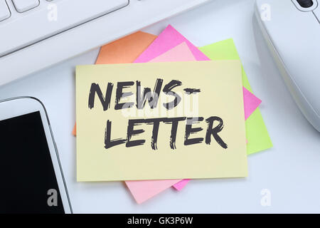Newsletter subscribing on internet for business marketing campaign desk computer keyboard - Stock Photo