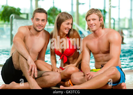 friends in the swimming pool - Stock Photo