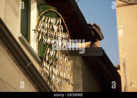 Italy, Lombardy region, wooden frames for drying fish in Peschiera Maraglio village on Montisola island - Stock Photo