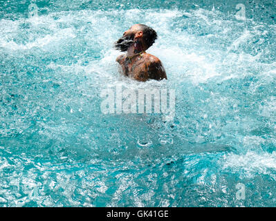 Man coming out of the water in a swimming pool - Stock Photo