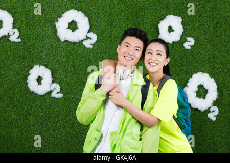Creative grass Young couple outdoor picnic - Stock Photo