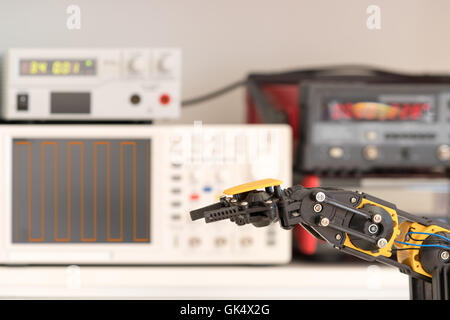 Plastic model of industrial robotics arm Robot manipulator - Stock Photo