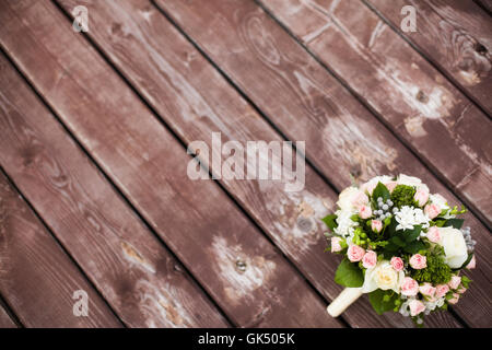 Beautiful wedding bouquet on vintage wooden background. Marriage concept - Stock Photo