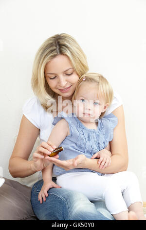 mother and daughter with globules - Stock Photo