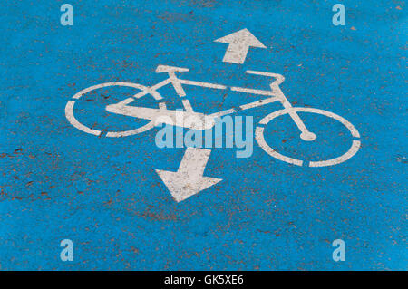 Blue Bicycle Road sign on the Asphalt ground for marking - Stock Photo