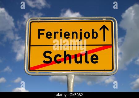 german ortsschild school holiday job - Stock Photo