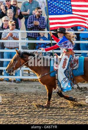 Rodeo Queen On Horseback With American Flag Chaffee