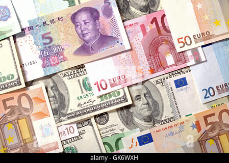 Dollars, Euro and Yuan  banknotes background - Stock Photo