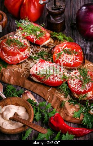 Eggplant and tomato stacks rustic - Stock Photo
