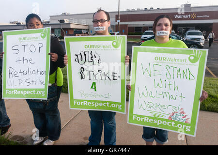Striking Walmart workers take the fight to Bentonville, protesting in front of home office to raise public awareness. - Stock Photo