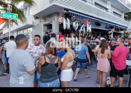 Miami Florida Beach South Beach Ocean Drive Palace Bar restaurant sidewalk cafe business LGBT gay bar drag Hispanic - Stock Photo