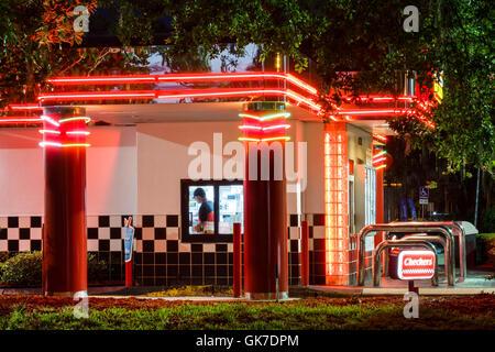 Florida Ellenton Checkers hamburgers fast food restaurant chain business building exterior lit sign branding neon - Stock Photo