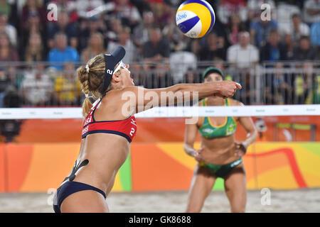 Rio de Janeiro, Brazil. 17th Aug, 2016. USA's April Ross (L) digs the ball during the Women's beach Volleyball semifinal - Stock Photo