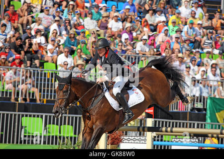 Rio de Janeiro, Brazil. 19th August, 2016. Nick Skelton of GBR on 'Big Star' in his Olympic Show Jumping Gold Medal - Stock Photo