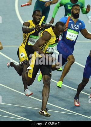 Rio De Janeiro, Brazil. 19th Aug, 2016. Jamaica's Usain Bolt (front) gets the baton from Nickel Ashmeade during - Stock Photo