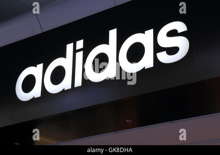 Logo of Adidas, German multinational corporation that designs and manufactures sports clothing and accessories. - Stock Photo