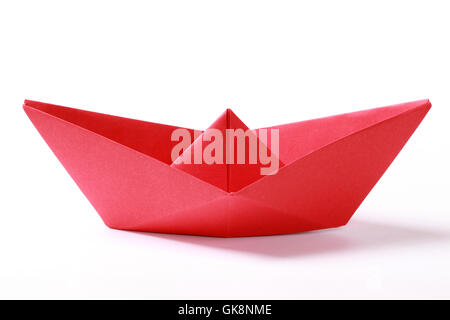 red paper boat - Stock Photo