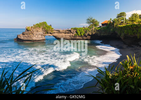Pura Batu Bolong temple on the beatiful rock in the morning light, Tanah Lot, Bali, Indonesia. - Stock Photo